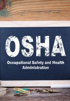 osha, Occupational Safety and Health Administration. Chalkboard on a wooden background.