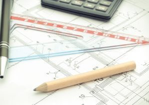 Drawing accessories and calculator on electrical construction drawing of house, building home cost concept