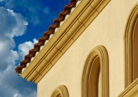 Abstract of New Stucco Wall Construction & Arched Windows